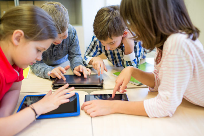 10676286 S Group Of School Kids With Tablet Pc In Classroom